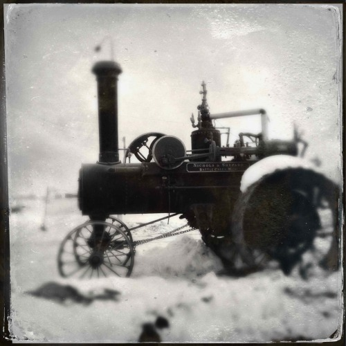 """Steam Tractor""   For your daily dose of Hipstamatic this image of a Nichols and Shepard steam tractor on 1st Ave North in Fargo.  I used the Tinto 1884 lens for the wet plate look. Hipstamatic 261, D Type Film with Tinto 1884 Lens"