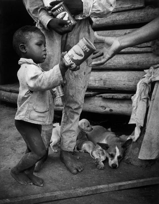 A family being given food. North Carolina, 1951. By W. Eugene Smith