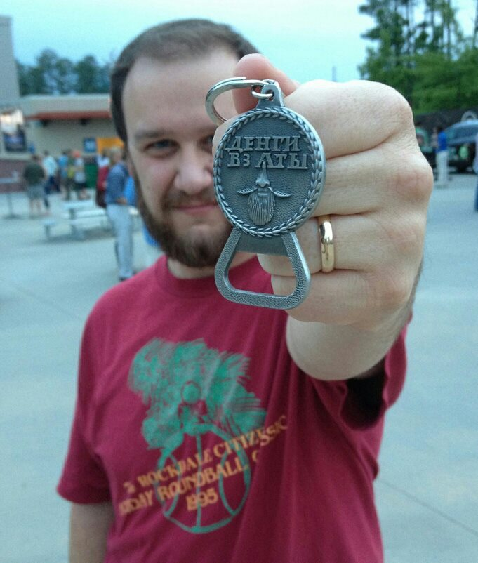 "Stephen O'Kane with his Beard Token bottle opener. He wrote, ""the first time I went out with my beard token: the Old Crow Medicine Show/Avett Brothers concert in Alpharetta, Ga. I haven't left home without it since."""