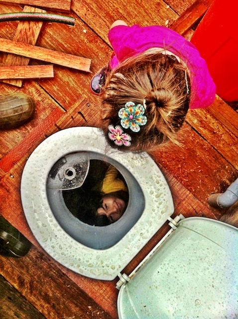 composting toilet seat and kids looking in