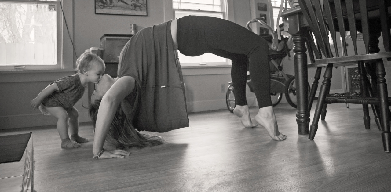 fuckyeahyoga:  I was coming out of a backbend when my daughter came up for a kiss.