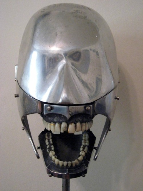 "1930: Dental Phantom ""Dental students worked on these for practice. The rivets protruding from the facial area would anchor a rubber face to make it more ""human"" to work on."""