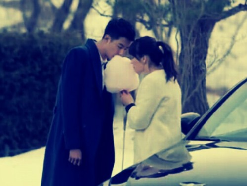 "Kdramas always have those mushy-cheesy-unforgettable scenes. Who will forget how Kim Joo Won wiped the whip cream off Gil Ra Im's lips (Secret Garden), how Jin-Ho said ""Game over"" and kissed Gae-in (Personal Taste) and now this cotton candy scene of Oh Young and Oh Soo (That Winter, The Wind Blows)."
