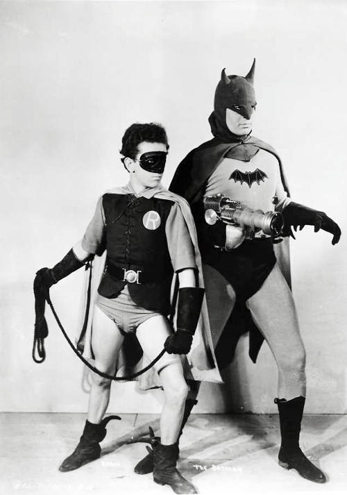 occultronic:   vintagemarlene: Lewis Wilson is batman and douglas croft is robin for 15 sizzling chapters in 1943's serial for batman (www.vintag.es)   Batman: The 1943 Serial Collection  1943NR2 discs This black-and-white 1940s serial started it all, with caped-crusader adventures involving a radium-powered death ray, a deadly alligator pit, electronic zombies — and even the original Bat Cave. Watch from the edge of your seat as the mild-mannered Bruce Wayne (Lewis Wilson) becomes the fearless superhero Batman, who, with the help of young Robin (Douglas Croft), protects Gotham City from the evil schemes of Dr. Tito Daka (J. Carrol Naish). I got these serials via NetFlix. Interesting stuff with loud propaganda overtones and much more of a noir feel than other Batman attempts. Kind of slow paced compared to the action we're accustomed to here in the future.