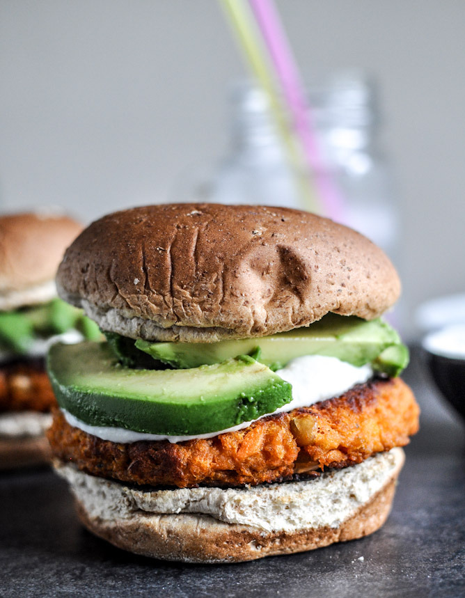 notanotherhealthyfoodblog:  smoky sweet potato burgers with roasted garlic cream and avocado.  click here for recipe