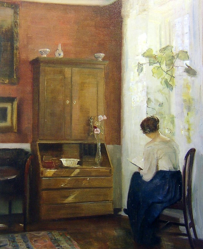 books0977:  Still Life with Young Girl Reading. Carl Vilhelm Holsoe (Danish, Post-Impressionism, 1863–1935). Oil on board. Connaught Brown. While Holsoe's airy brushwork evokes a sense of space, his also shows the magical pure light of the long Scandinavian summer days. In 'Girl Reading' the white muslin curtain increases the glowing intensity of the sunlight, producing a radiant warmth as the woman sits, happily absorbed in her book. This is a combination of luminous domesticity and meditative calm.
