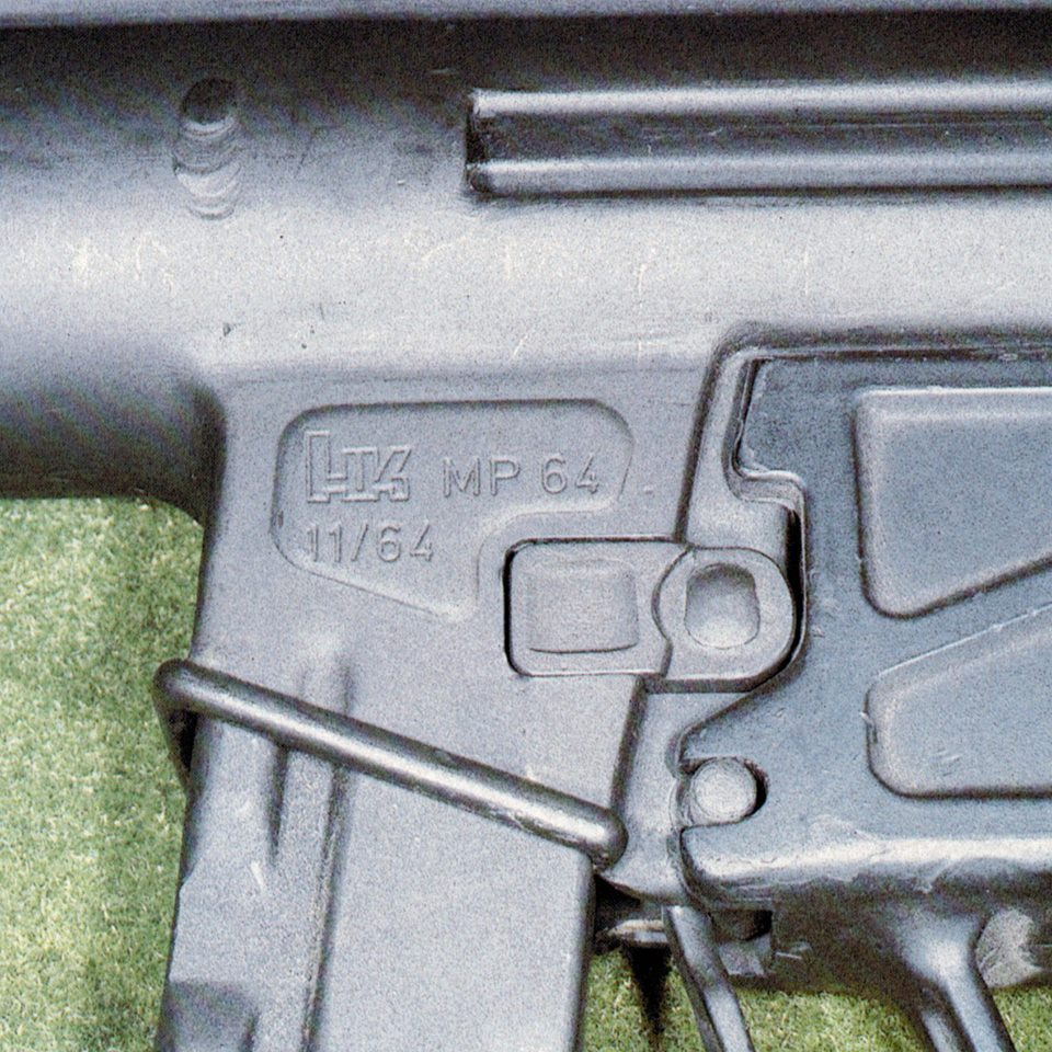 Heckler & Koch  Second Prototype Development of the MP5 1964年11月 The second prototype submachine gun was marked with the project code number, 64. This was completed in November 1964. The second subgun featured an experimental pin-end-grove arrangement for fastening the trigger group to the firearm's receiver. Photo Credit: Frank W. James, Author of MP5 Submachine Gun.