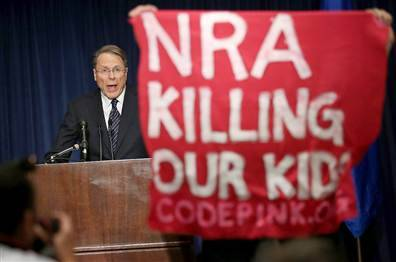 "breakingnews:  NRA rejects gun controls, blames violent video games and movies National Rifle Association CEO Wayne LaPierre defiantly blamed violent video games and movies, the media, gun-free zones in schools and other factors during the organization's first public statement following the elementary school shooting in Newtown, Conn. last week.  NBC News reports:  LaPierre, who was interrupted by Code Pink protesters twice during a statement (during which he refused to answer questions), said that the students in Newtown might have been better protected had officials at Sandy Hook Elementary been armed. He said that putting a police officer in every single school in America might make schools safer. ""The only thing that stops a bad guy with a gun is a good guy with a gun,"" he said, asking Congress to immediately appropriate the money to put a police officer in every single school in the country.  Photo via NBCNews.com"