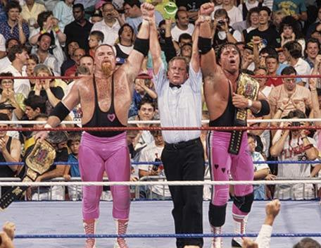 "30 Days of wrestling, day 6:  Favorite Tag Team The Hart Foundation  I've always been a fan of tag teams that fill the obvious deficiencies in each other.  A speed guy and a power guy, that's pretty much perfect in my head.  That's what makes me disqualify a LOT of teams in my head as possible favorites.  I loved the Killer Bees, but they were small and fast guys, and they regularly got pounded into smears on the mat against larger, muscle-teams.  Road Warriors?  AWESOME.  However, they had no brains between 'em.  They were giant slabs of beef who were regularly outsmarted by the Horsemen.  Rick and Scott Steiner broke the curve, because they were freaking giant muscle men who could hang with ANY great wrestler, as was proven when they regularly smashed my number two favorite tag team of all-time THE MIDNIGHT FUCKING EXPRESS into kindling.  I don't think the Midnight Express ever beat the Steiners.  Not once. ON TOPIC:  Bret ""Hitman"" Hart, the science, the speed, the technical skill.  The Excellence of Execution, even back then, as branded by Gorilla Monsoon and Jesse The Body.  Jim ""the Anvil"" Neidhart, the gorilla of the team, presented on commentary as someone who could go toe to toe with anyone in the business (ALTHOUGH, POINT OF ORDER, I NEVER DID GET TO SEE THE HARTS VS. THE MEGAPOWERS.  WE WANTED IT, PRECIOUS).  Two time tag-team champions, and actually probably participated in the single best tag-team match I've ever seen, a best two out of three falls match against the BrainBusters (VIVA LA TULLY AND ARN.  Only use I ever had for Tully Blanchard, really).  The Hart Foundation were medically incapable of having bad matches.  Except with Nikolai Volkoff and Boris Zukhov.   They were good.  Not GODS."