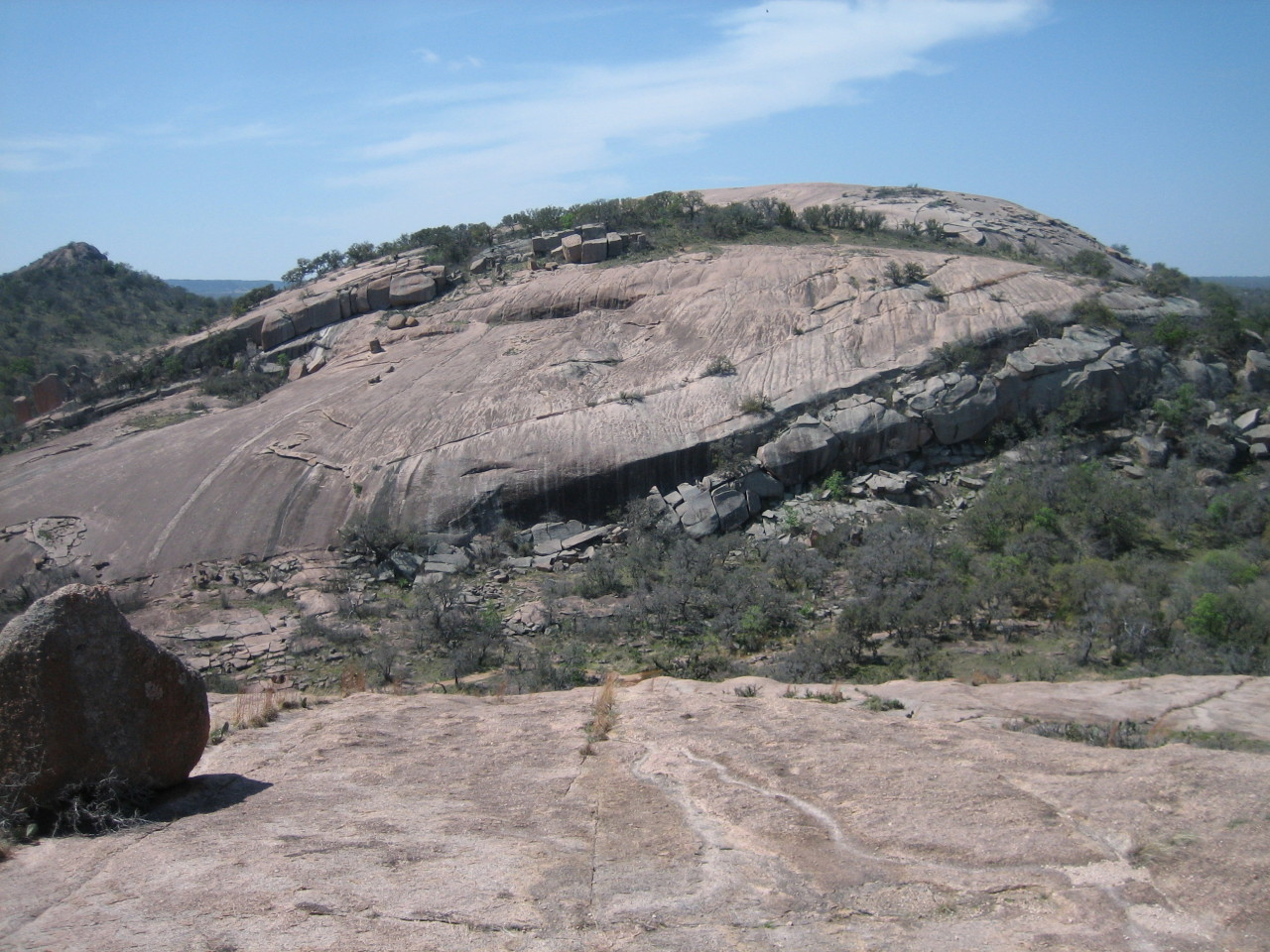 "Enchanted Rock State Park [March 2013] When asked about the reason for coming to Austin Texas, most were surprised to learn that I wasn't there for Sxsw.  ""Just plain business trip"", I said, ""and a bit of climbing on the side"". [[MORE]] Being 2 hours drive away, Enchanted Rock is pretty much the only place around Austin for trad. I had my heart set to check out the place, but finding climbing partners in a foreign city could be difficult.  But then I thought - how cool would it be to organize a climbing trip through Meetup, and make some new friends along the way! Sure enough, a dozen people signed up without knowing that me, the ""organizer"", is not even a local. And within hours of landing, I was hanging out with a bunch of awesome people and was happily jamming my way up granite walls. The climbing there reminded me of JTree cracks and Squamish slabs. In fact, most of us have never been there before. We were there for the entire day, sampling everything from tips to OW and straight-in cracks to friction slab. To top it off, we stopped by Cooper's Old Time Pit at Llano for some authentic Texas all-meat BBQ. I came back again the next day with Eric, whom I met through erockonline, to climb a bunch of classic lines in the park. Yeah, this place was that good. Contrary to my stereotype about the Midwest, most of the people here in Austin are actually very friendly (except for those who designed the highways and roads).  The vibe is chill and the bars are cool. Hopefully I will be back again for more climbing and of course, the BBQ.  Grass Crack on the left and scary looking OW on the right at Triple Crack Sanctuary Fear of Flying, a WIDE crack that most mortals on TR would just lieback the crap out of it"
