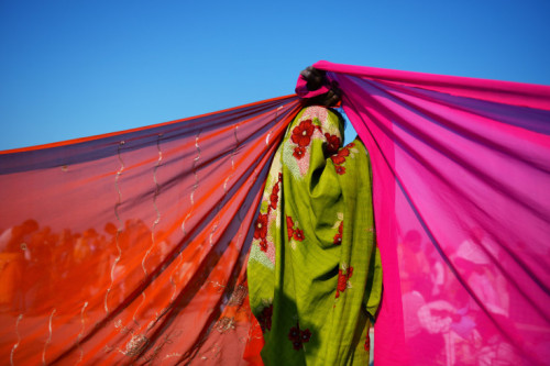 Roberto Schmidt—AFP/Getty Images  Feb. 10, 2013. An Indian woman holds up the corners of two saris to dry on the banks of the confluence of the Yamuna, Ganges and mythical Saraswati rivers at the Kumbh Mela in Allahabad, India. Read more: http://lightbox.time.com/2013/02/15/pictures-of-the-week-february-8-february-15/#ixzz2L70zU4ob