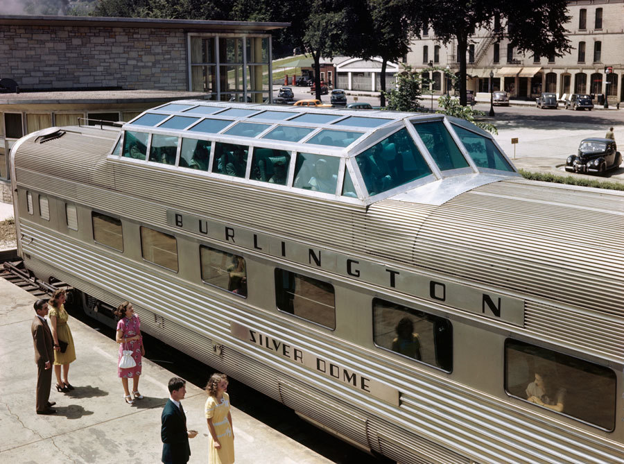 The Burlington Silver Dome, the orginal Vista Dome deluxe coach wagon with a glass compartment with 24 seats, rising out of the roof giving an inobstructed view at the sceneries during travel. The Vista-Dome car was conceived by Cyrus Osborn, a General Motors vice president, in 1944 as he rode in the diesel locomotive of a freight train in the Glenwood Canyon. Overtaken with the views that were not obscured by the walls of a passenger car, he contemplated a method to provide passengers with the same breathtaking views he was experiencing and started sketching a way to provide train passengers a means of viewing the scenery. This prototype car was named Silver Dome and was put into service in 1945. Kodachrome photo by Willard R. Culver.