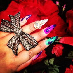 queenofblending:  Bits of my outfit today! Ring from @elessajade, nails by @nail_swag, Rose dress from #HotTopic, red pettiskirt from pettiskirtstyle.com, black & roses knee high socks by #BetseyJohnson! (at California Market Center)