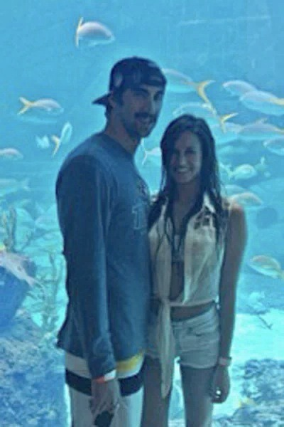 So. Here's a pictures of famed Olympic swimmer Michael Phelps and possible new girlfriend, Sarah Herndon. This is was we know so far: Sarah is 22, a waitress, and ridiculously HOT!