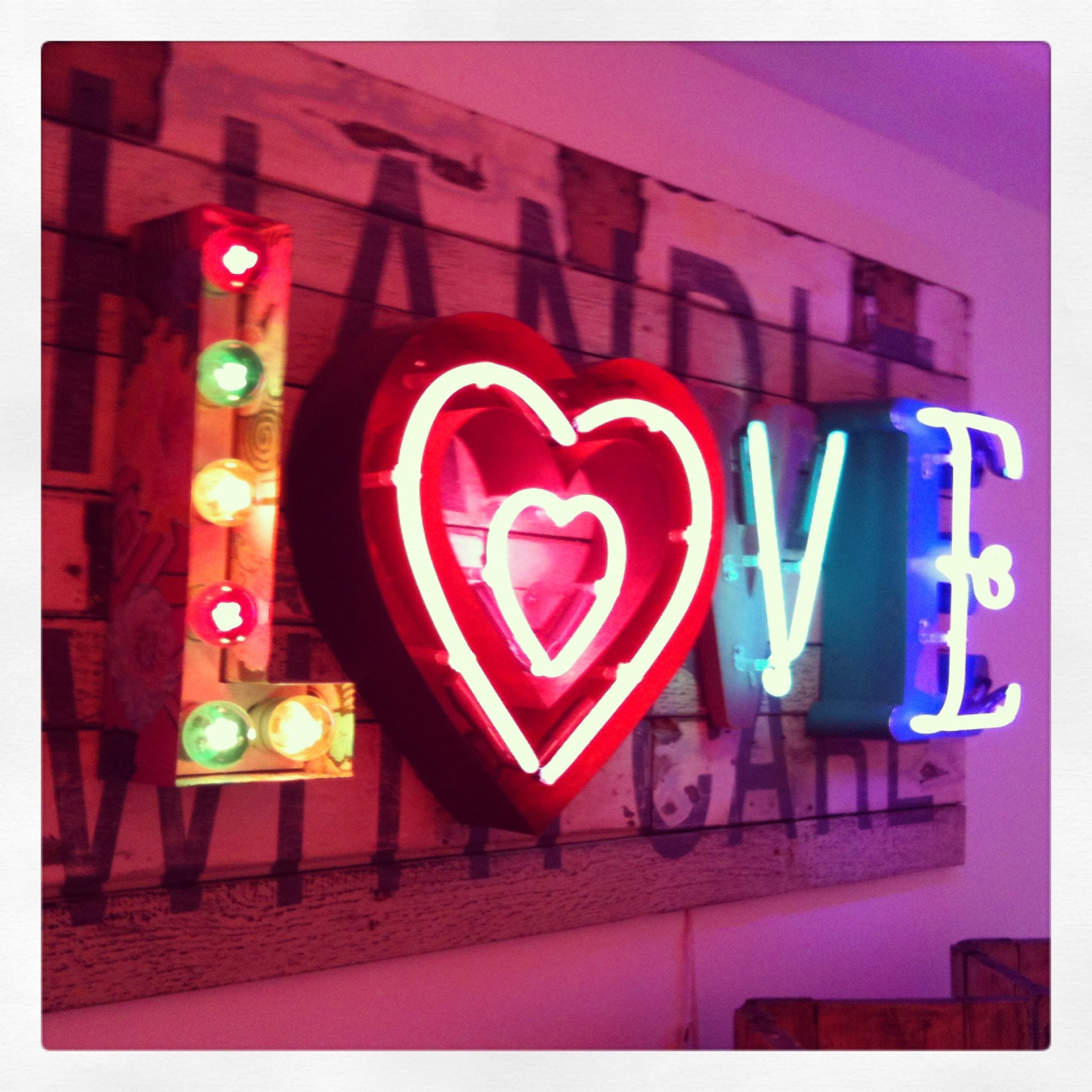 "typeworship:  Neon Love This fantastic artwork is by Chris Bracey — aka the Neon Man — who has been producing light-up creations for 37 years. Some friends just acquired this piece for his pop-up gallery in London's Soho. The letters are mounted on reclaimed wood from from a shipping crate, emblazoned with the words ""Handle with care"" stencilled on. Nice touch."