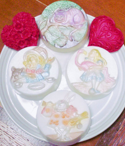 """Alice in Wonderland"" Soap Set by thecharmingfrog Each is scented differently. Alice: Ruby Red Grapefruit Mad Hatter: White Tea The White Rabbit: Cotton Blossom The Cheshire Cat: White Chocolate"