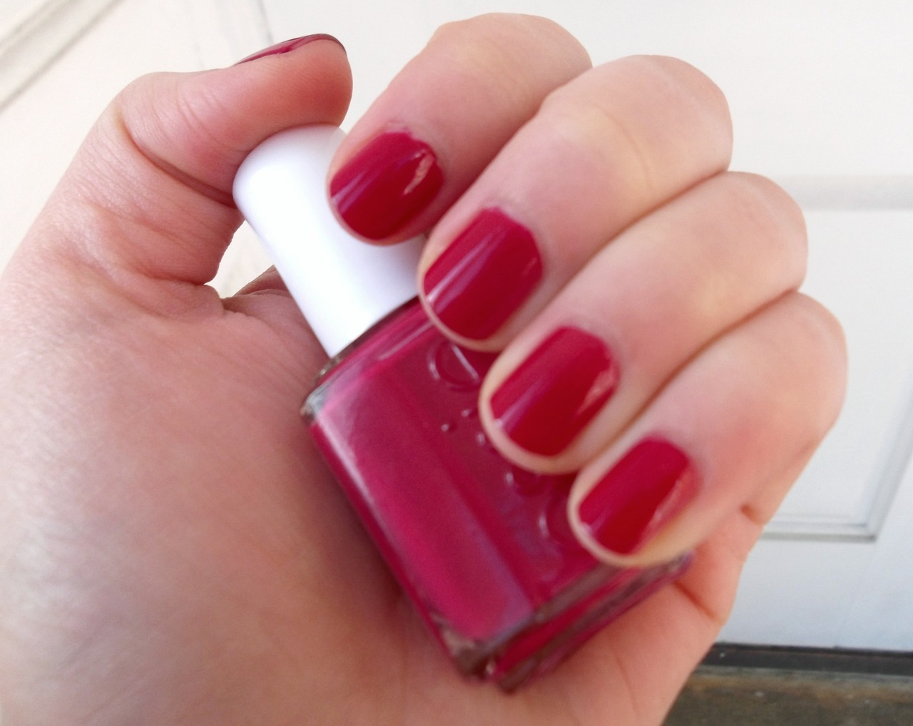 Today's Nails: Essie Plumberry Happy December! As nothing is more seasonally-appropriate than red nail polish, I thought I'd share Plumberry, a vibrant raspberry red. This is the only red I own and it honestly reminds me more of summer than of Christmas. But it's a great option for those who are scared of full-on red nail polish, because it's a fairly pink red (with a touch of purple). It has a shiny, gel-like finish and makes your fingers look really juicy.