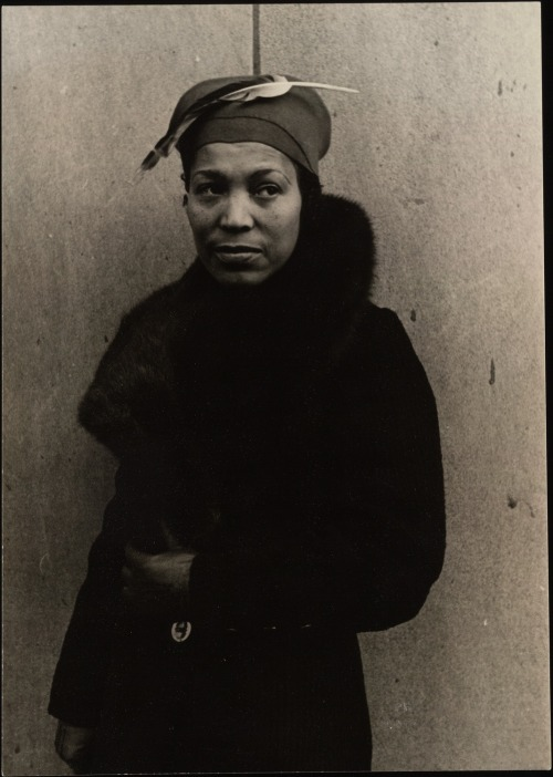 "vintageblackglamour:  Zora Neale Hurston, born on this day in 1891, wrote these words in her 1950 essay, What White Publishers Won't Print. ""For various reasons, the average, struggling, non-morbid Negro is the best-kept secret in America. His revelation to the public is the thing needed to do away with that feeling of difference which inspires fear, and which ever expresses itself in dislike. It is inevitable that this knowledge will destroy many illusions and romantic traditions which America probably likes to have around. But then, we have no record of anybody sinking into a lingering death on finding out that there was no Santa Claus. The old world will take it in its stride. The realization that Negroes are no better nor no worse, and at times just as bonny as everybody else, will hardly kill off the population of the nation.""  This photo was taken on November 9, 1934 in Chicago by Carl Van Vechten. Via Beinecke Rare Book and Manuscript Library"