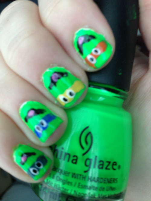 nailedandconfused:  Teenage mutant ninja turtle nails  Polishes used: China glaze Kiwi Kool-aid-a Sally hansen Xtreme wear in White on, black out,cherry red, mellow yellow, pacific blue and plum power