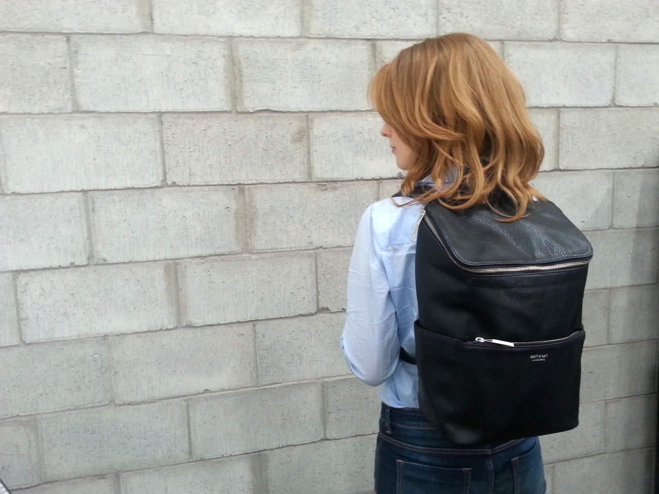 Ellen wearing the Brave backpack