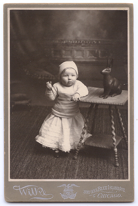 ca. 1880-1900's, [cabinet card, portrait of a child with a knife and a chocolate bunny], Wilke via Capitol Gallery, 19th Century Paper Photography