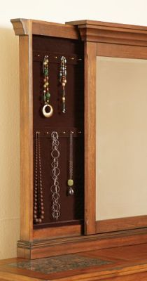 Secret jewelry compartment behind dresser mirror - furniture