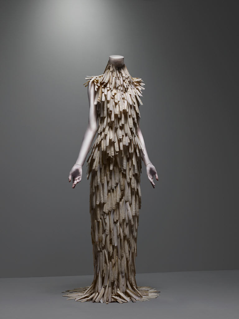 "Alexander McQueen: VOSS, Spring/Summer 2001 Razor-clam shells stripped and varnished. In McQueen's Words:  ""My friend George and I were walking on the beach in Norfolk, and there were thousands of [razor-clam] shells. They were so beautiful, I thought I had to do something with them. So, we decided to make [a dress] out of them… . The shells had outlived their usefulness on the beach, so we put them to another use on a dress. Then Erin [O'Conner] came out and trashed the dress, so their usefulness was over once again. Kind of like fashion, really."" WWD, September 28, 2000"