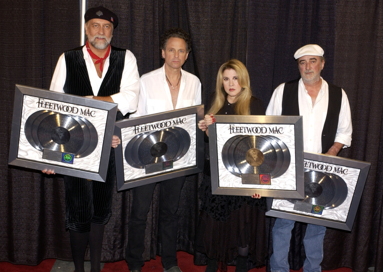 Fleetwood Mac overcome with joy after receiving a RIAA award for 50 million US sales.