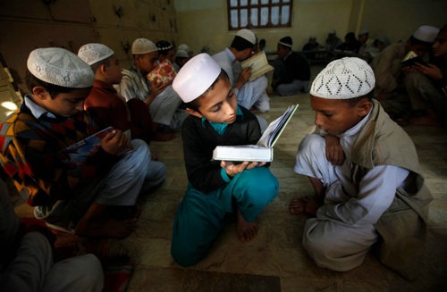 Athar Hussain/Reuters Students in Karachi, Pakistan, studying the Koran at the Jamia Binoria Al-Alamia Seminary Islamic Study School. About 6,000 boys and girls are educated, fed and housed at the madras, or religious school.