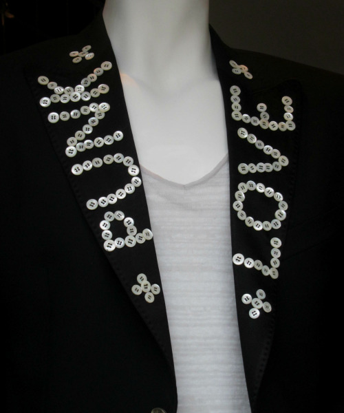 Pearly King embellishment for men's blazers at John Richmond. WGSN store shot, Paris