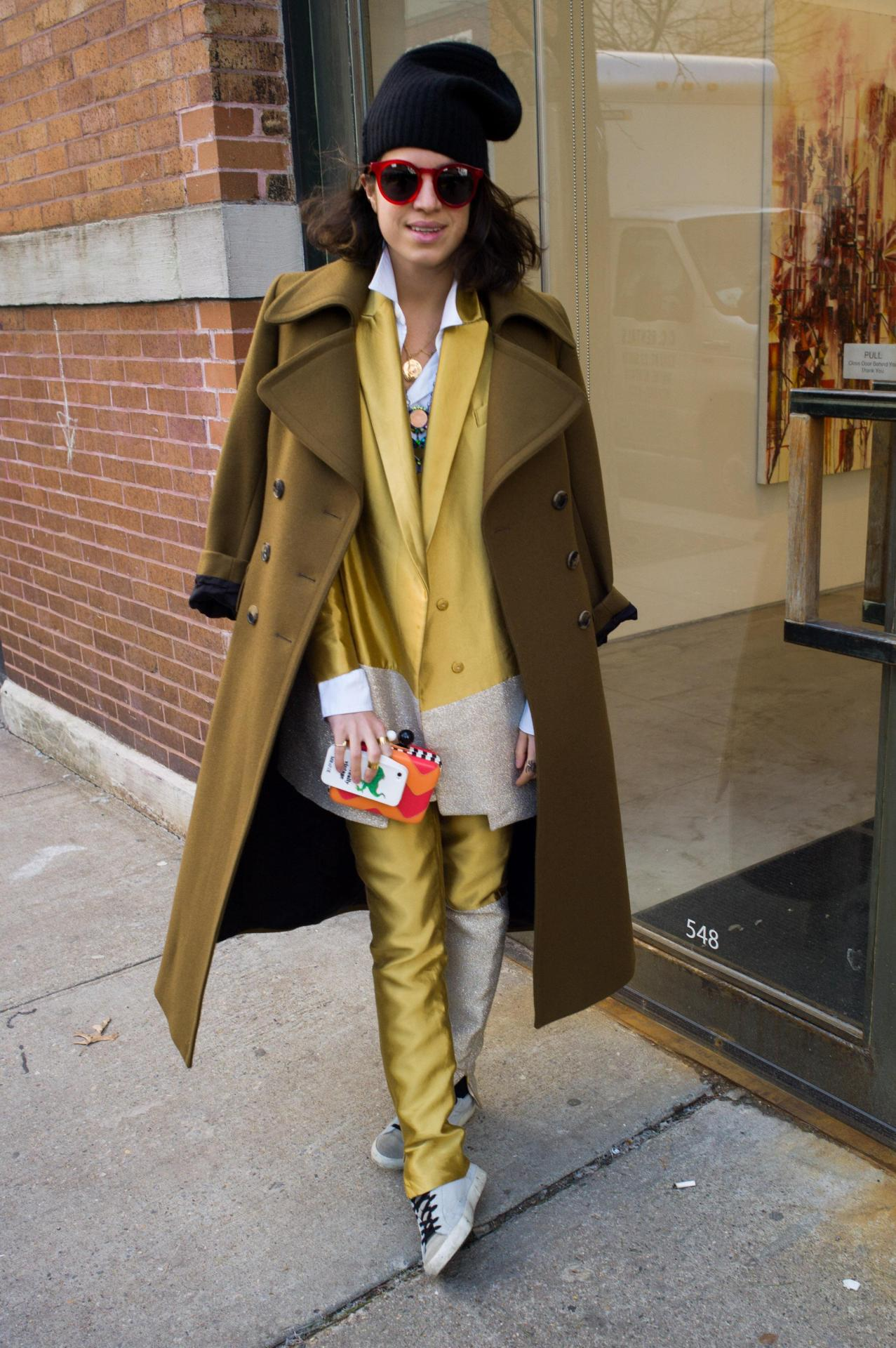 "Leandra Medine vs Suzy Menkes Here's Leandra Medine (aka the Man Repeller) rocking her golden mustard suit at the Rodarte Fall 2013 show. Her closing essay on Fashion Week (""Blog is a Dirty Word"") presented a very articulate counterpoint to Suzy Menkes' T Magazine piece, ""The Circus of Fashion"". Suzy's piece received 42 comments whereas Leandra received a whopping 132, but who's keeping count? The debate about the new army of bloggers and their validity is a powerful one, so give both articles a chance. Lots of truth is expressed in each.  (Photo: Jesse Lirola/BFAnyc.com. Text by Jauretsi)"