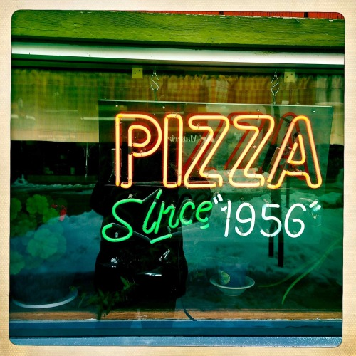 """Pizza Since 1956""  For you daily dose of Hipstamatic this image of a neon pizza sign. This sign is in the window of ""Sammy""s"" pizza on Broadway in downtown Fargo, North Dakota.  A great pizza, give them a try. Hipstamatic 261 with John S lens and Ina's 1969 film"