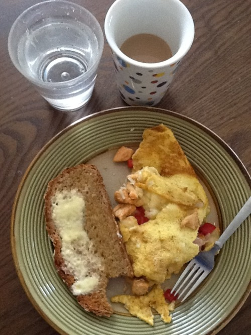 Meanie Baby's BD Breakfast. Chicken, red pepper, mozzarella, omelette. Whole grain toast with butter. Cup o'joe, water and yogurt (not pictured)