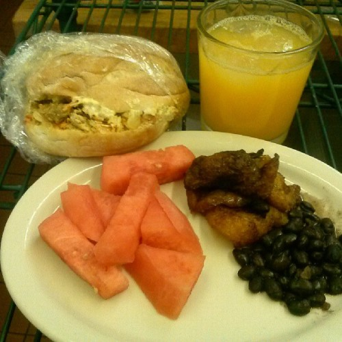 Finally having breakfast…so I guess brunchm #brunch #watermelon #orangejuice #platanos #frijoles #chickensandwich #food