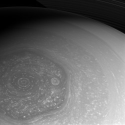 scinerds:   Summer is Coming!  Summer is slowly coming to Saturn's northern hemisphere. The north pole, which was in the midst of a 7-year-long winter when Cassini arrived in 2004, is now seen basking in the sunlight of mid-spring. Cassini is taking full advantage of the sunlight to capture these amazing views of the north polar hexagon and the myriad of storms, large and small, that comprise the weather systems in the polar region. This view is centered on terrain at 75 degrees north latitude, 322 degrees west longitude. The image was taken with the Cassini spacecraft wide-angle camera on Feb. 26, 2013 using a spectral filter sensitive to wavelengths of near-infrared light centered at 752 nanometers. The view was acquired at a distance of approximately 383,000 miles (616,000 kilometers) from Saturn and at a Sun-Saturn-spacecraft, or phase, angle of 48 degrees. Image scale is 21 miles (33 kilometers) per pixel.