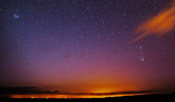 Panstarrs comet and Andromeda Galaxy by ronstrathdee