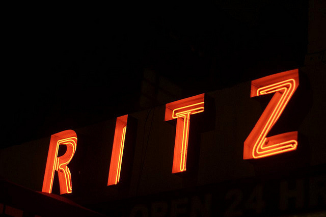 "Ritz Diner(on First Avenue at 62nd Street in the Upper East Side) I needed some solace today, both from the terrible news from Boston and from the day-to-day weariness of this and that. Milkshakes soothe both my soul and my stomach, so I stopped in at the Ritz Diner at lunch time for a chocolate shake to go. The Ritz is, despite what the website says (""not just a diner, but a 'ritzy' diner""), a pretty classic diner (with pretty classic prices, considering the neighborhood). Counter, tables, grilled cheese, etc. — it's all there. Most importantly, it is:  The main sign is pretty straightforward — just mazy channel letters spelling out RITZ DINER — but that seems about right for this place. I need to go back some time after dark and get better photos (these are old), though it's a big tricky with the awning. For now I'll just say I'm glad the Ritz is still keeping 1st Avenue aglow (along with Goldberger's and others)."