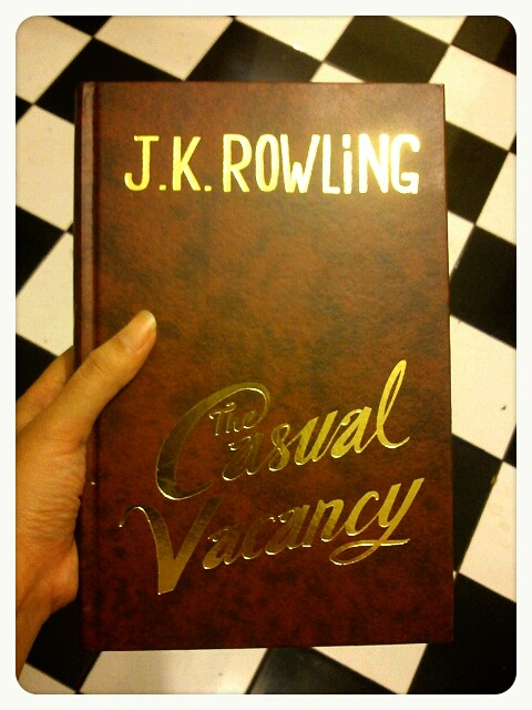 What I'm reading now :) The Casual Vacancy by J.K. Rowling.   And, yes, I have a checkered floor tiles in my house. Sometimes it makes me dizzy, yes.