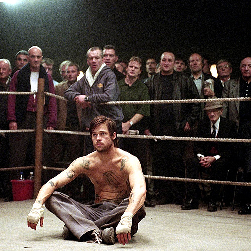 "Snatch (2000) source: @TheScriptLab #screenwriting #film #story ""Screenplay Genre: Crime / Thriller  Movie Time: 103 minutes  INCITING INCIDENT  Franky Four Fingers (Benicio Del Toro) heists an 84 carat diamond that sparks the interest of diamond sellers Avi (Dennis Farina) and Doug the Head (Mike Reid) during the time unlicensed boxing promoter Turkish (Jason Statham) and his partner Tommy (Stephen Graham) reach a deal for their fighter Gorgeous George (Adam Fogerty) with malicious boxing kingpin Brick Top (Alan Ford). (00:11:44)  LOCK IN (End of Act One)  Acting on a tip, Boris the Blade (Rade Sherbedgia) commissions two-bit thugs Sol (Lennie James) and Vince (Robbie Gee) to take down a bookie and steal a briefcase from a man with four fingers. They hire Tyrone (Ade) who fusses over Vince's dog, to be their getaway driver.  Meanwhile, Tommy puts Gorgeous George in a bare-knuckle fight against the gypsy Mickey (Brad Pitt), but Mickey breaks Gorgeous George's jaw, knocking him out of Brick Top's fight.  Turkish and Tommy have no choice but to get Mickey to replace Gorgeous George and fight for them. (00:29:50)  FIRST CULMINATION (Midpoint)  Sol and Vince botch the robbery and learn they held up one of Brick Top's bookies. They discover the briefcase contains the massive diamond and want in, but Boris has other plans and Avi is on his way to get his diamond.  Brick Top assures the betters that Mickey will go down in the fourth round, but Mickey knocks his opponent out with one punch, landing Turkish and Tommy in Brick Top's debt. Turkish and Tommy need to make Mickey fight again, but he won't do it unless they buy his mom a new camper. (1:02:19)  MAIN CULMINATION (End of Act Two) Brick Top smashes up Turkish and Tommy's casino and burns down Mickey's mom's camper, with her still inside, in order to make Mickey fight. After the wake, Mickey goes on a wild bender and is stone drunk minutes before the fight. Brick Top warns Mickey that his gypsy camp is fucked if he doesn't cooperate this time. In the city, Avi and his….."""