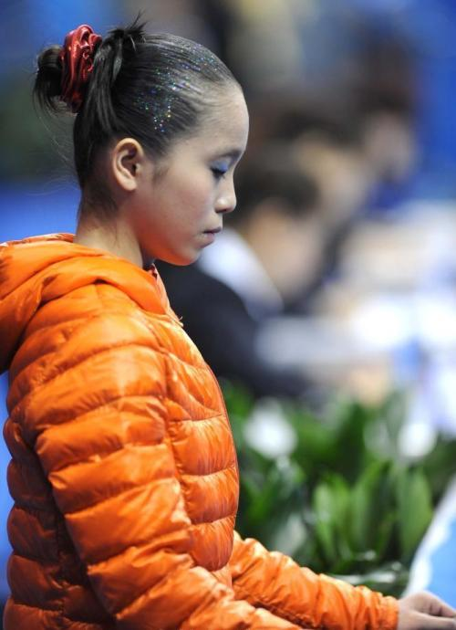Yao Back on Top ^_^ Yao Jinnan has qualified 1st into the all-around competition and lead the rest of the field by almost 3 points at the 2013 Chinese National Gymnastics Championship. She's still competing her London Olympics routines at this point. We'll see if she upgrades for the final.  Here are the standings after the qualifications; all scores are based on the ridiculous and demoralizing Chinese judging system, so feel free to add a point or two to the total ^.~: Yao Jinnan              57.468 Shang Chunsong    54.735 Huang Qiushuang   54.735 Zeng Siqi                 54.635 Liu Tingting             54.582 Xiao Kangjun           54.402 Tan Sixin                  54.401 Huang Huidan         54.168 Luo Peiru                53.868 Lu Jiaqi                   53.768 Deng Linlin             53.535 (Photo Credit: Ni Minzhe)