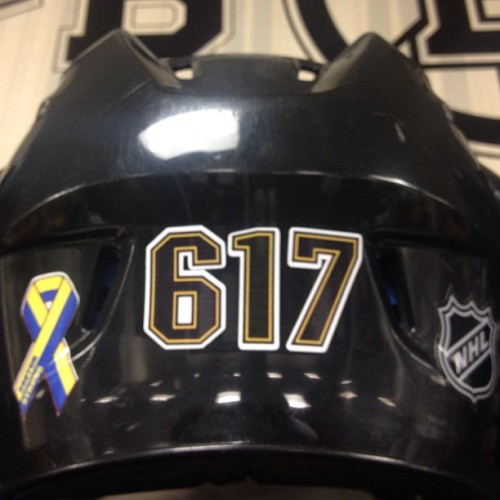 nhlbruins:  Helmet in the B's locker room representing the 617 #BostonStrong  617 enough said