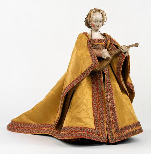 Cisterspielerin (Maiden Playing the Cittern) | Mechanical Doll, 16th Century    This antique German mechanical doll plays the cittern, turns its head and seems to mince along with tiny steps while in fact running on wheels. Movement conveys the impression of life. The imitation of life is among the ancient dreams of mankind, already reflected in the myths of antiquity. At that period, technology and the arts were still considered to be identical. With the help of mechanisms, artists and artisans tried to imitate Gods creation as if by magic. Androids like this mechanical doll are automatons that are not able to act by themselves. Once started, they can only function on a pre-programmed basis, yet the amazed on-looker is prepared to take the inanimate doll as having magically come to life for as long as the movement lasts.
