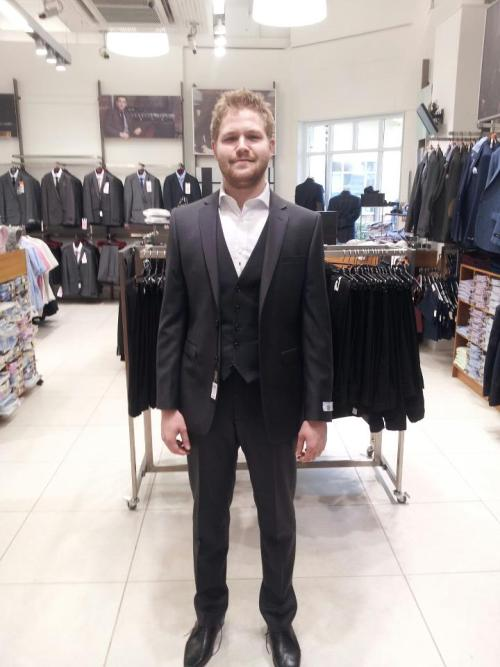 Me (standing slightly dorkishly) in my new suit lol.