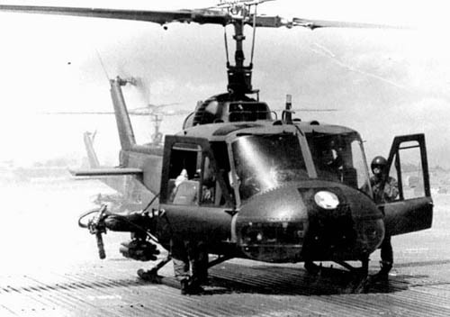 "greasegunburgers:  The North Vietnamese pressure forced Thailand to dispatch ""volunteer"" UNITY battalions into Laos at the end of 1970 to stabilize the situation. These Thai troops were supported by an UH-1M gunship helicopter squadron, known as the ""White Horses"" according to their radio-code and the unit's insignia painted on the nose of the machines. These helicopters officially belonged to the RLAF but in reality they were run independently by the Thais and the CIA. Three CIA-trained Hmong pilots flew with the unit that was disbanded in 1973. The machines were intended to be handed over to the Thais but at that date the regime in Bangkok was opposed by many mass-demonstrations claiming a democratization of the society. Fearing that the government could use the gunships against the protesting students, the CIA decided to scrap them altogether!  (Photo: Ken Conboy via Albert Grandolini)"