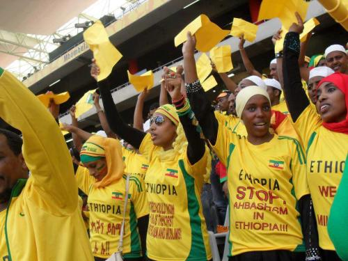 footybedsheets:  globalvoices:   IMAGE: Ethiopian Muslims protest the Ethiopian Government while supporting the Ethiopian Team in South Africa at The Cup of African Nations 2013. From the Awolia School Support Page Facebook Page Ethiopians across the world are celebrating TeamEthiopia, their national Soccer team, who fought a hard draw against defending champions Zambia in the 2013 Africa Cup of Nations in Nelspruit, South Africa.   Sport brings people together. The cheerful Oromo crowd in South Africa today is a good example of that. In the states, rarely do we see both sides (Oromo and other Ethiopians) cheering for the same team. We have separate sporting tournaments and federations. For Ethiopia's football fans in South Africa, the choice today was between OLF flag, the defacto Oromo flag, and the EPRDF (Ethiopia's ruling party) flag. As you have said so eloquently, whether the Oromo and non-Oromo fans of Team Ethiopia displayed different flags didn't matter. They both supported one team. For far too long, at international sporting events and bazaars, a monolithic image of Ethiopia have been presented to the world. An Ethiopia with 3000 years of history that is still a christian island, has one flag, and speaks only Amharic. But in reality, Ethiopia is a truly diverse nation with divergent aspirations and historical experiences. As a result, contending national sentiments (isms) have emerged. Under previous Ethiopian regimes, for example, the use of Afan Oromo in public spaces and government offices was banned.   Besides the beauty of the Ethiopian game and the composure the players showed after a long absence from the AFCON tournament, Ethiopian politics was at the centre of online discussion. Ethiopian fans in the stadium displayed various placards and flags representing different political interests. Read: Waving Different Flags, Ethiopians Celebrate their Fight in AFCON 2013   Adding this to the themes of DO NOT JUDGE a fan or supporter based on what they look like.  FOOTBALL IS BEAUTIFUL. AND IT IS FOR ALL OF US.