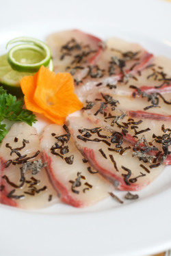 Kanpachi Carpacio with shiokonbu and drizzled with truffle oil. Shiokonbu is a salty dried seaweed and I don't really like the smell of truffle oil but it tasted DELICIOUS!! Photo for En Dining.
