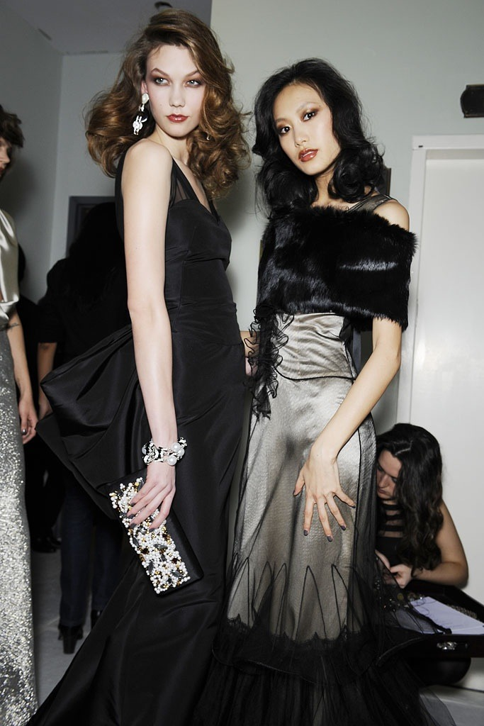 Karlie Kloss and  Shu Pei Qin Backstage at Oscar De La Renta Fall 2010-RTW