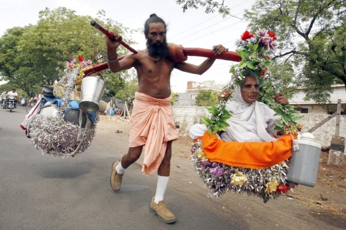 awkwardsituationist:  kailash giri carries his 88 year old mother, kirti devi, who is visually impaired, in new delhi as they travel on a pilgrimage to visit all major hindu pilgrimage sites in india before she dies. april 18 2013. photo sanjeev gupta