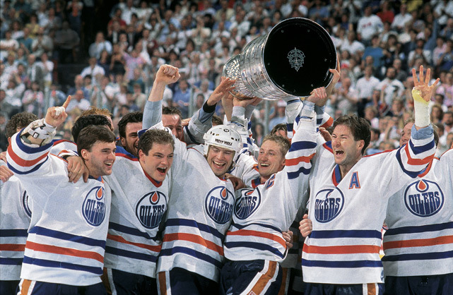 Members of the Edmonton Oilers — Bill Ranford, Esa Tikkanen, Mark Messier, Wayne Gretzky and Kevin Lowe — celebrate after defeating the Bruins for the 1988 Stanley Cup championship. (David E. Klutho/SI) GALLERY: Rare Photos of Wayne Gretzky