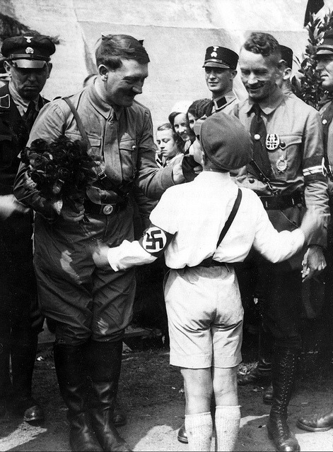 n0vapr0spekt:  Adolf Hitler reçoit un bouquet de fleurs d'un enfant by ww2gallery on Flickr.